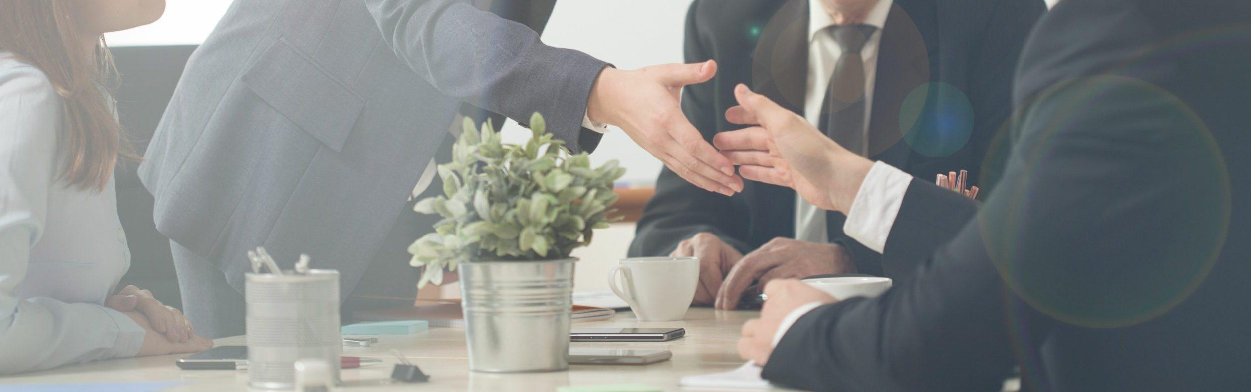Panorama of handshake on a business meeting
